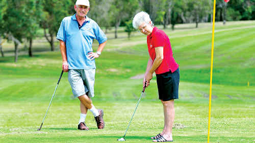 Cooroy Golf Club players Peter Jeucken and Diane Payne enjoy a round.