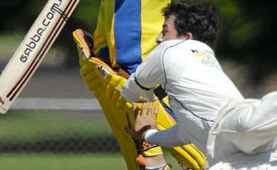 Railways bowler Brendan Jones collides with Northern Brothers Diggers opener Shaun Cartwright during yesterday's one-day final.