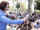 Prime Minister Julia Gillard waves to the crowd at Toowoomba's Australia Day celebrations.