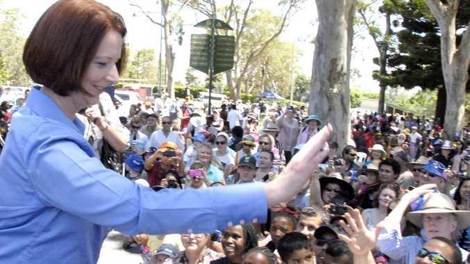 Prime Minister Julia Gillard waves to the crowd at Toowoomba's Australia Day celebrations.