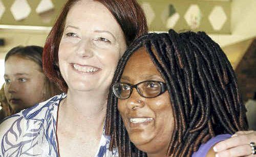 Prime Minister Julia Gillard meets student Flosy Ganier at the Ipswich Showgrounds flood evacuation centre.
