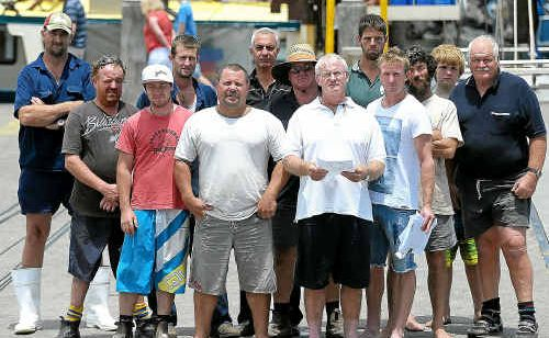 Russel Kerr, front right, from Coffs Harbour Fishermen's Co-op, meets with other disgruntled fishermen.