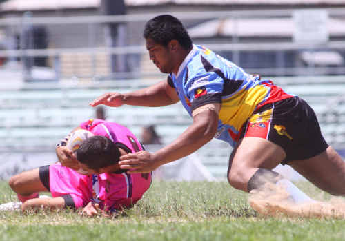 QUICK HANDS: Highlands' Chris Conway on the attack during the Indigenous Reconciliation Carnival played in Rockhampton. Photo: Chris Ison / The Morning Bulletin