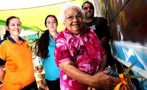 Art opening: Aunty Kath unveils the mural with, from right, Robert Appo, Karly Hawkins and Karen Powell.