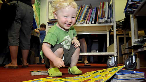 Oren Williams (18months) delights in a picture book at the Friends of the Toowoomba City Library book sale on Saturday.