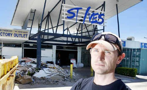 Martin Schultz, owner of the Discount Drug Store in St Ives Shopping Centre in Goodna, is upset that his insurance company is refusing to pay out.