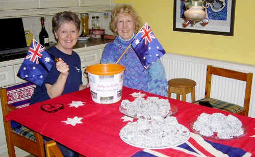 England's Alma Longman and friend Mary Quinton cook up funds for flood victims.