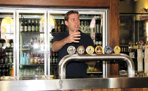 PASSIONATE: Head brewer Mitch Bradey explains each beer variety.