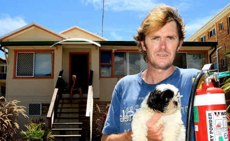 Fast thinker Christopher McCure with dog Sammy escaped the potential fire disaster.