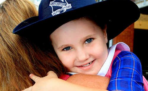 Growing up: Mum Tiffany A'Bell gets a last hug from Aleksia before school.