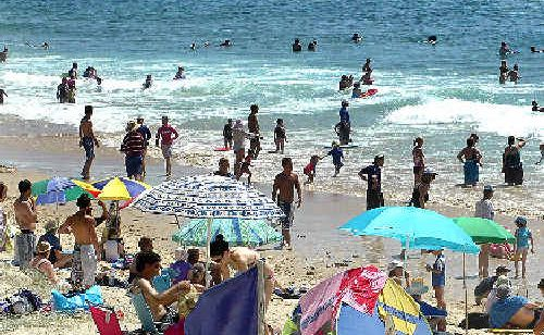 Crowds flock to local beaches to beat the heatwave conditions.