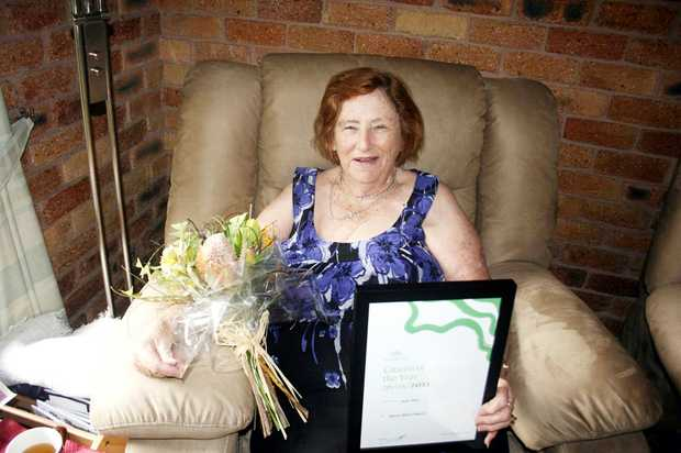 Jean Platt shows off the award she won for the Byron Shire Citizen of the Year 2011.