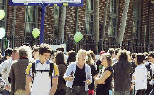 A file image of students gathered outside Mullumbimby High School to remember Jai Morcom a year after he died in the playground in 2009.