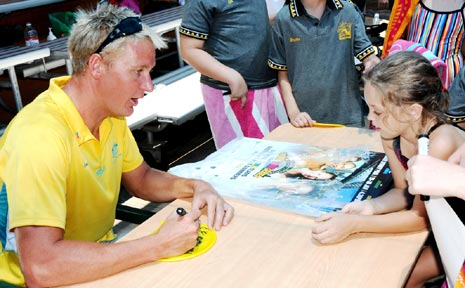 OLYMPIC AND COMMONWEALTH medallist Brenton Rickard signs posters and other memorabilia for adoring fans at Gatton Pool during the Australia Day Carnival last week.