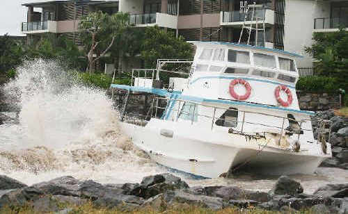 Pounding seas driven by winds from Cyclone Yasi of more than 100kmh, pushed this boat onto rocks in the Whitsundays.