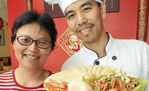 HAPPY NEW YEAR: Patsy Gerver and Kevin Hu, of China Flute Gourmet Restaurant, celebrate with their shredded pork fillets in peking sauce.