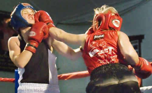 Jessica Retallack (in red) fights at Cooroy.