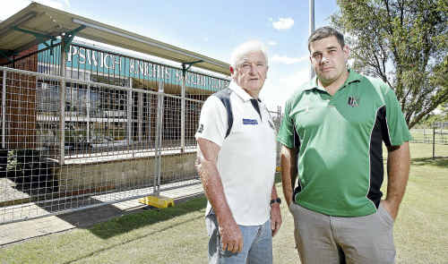 Ipswich Knights life member Rob Hughes (left) with president Troy Beahan outside the Knights clubhouse which has to be knocked down due to flood damage.