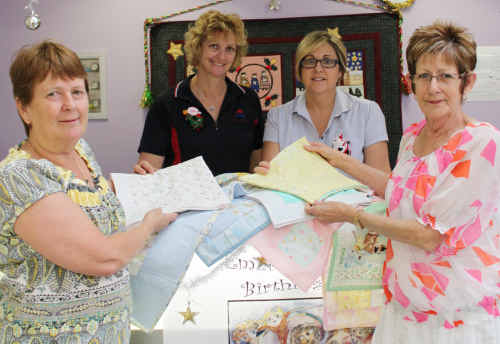 MADE WITH LOVE: Ladies from Emerald Patchwork and Quilters Group donate quilts to Emerald Hospital. rp-211210-005