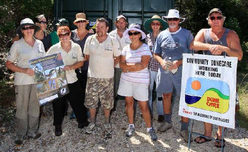 Dune care volunteers are stepping up pressure to stop a proposed caravan park.