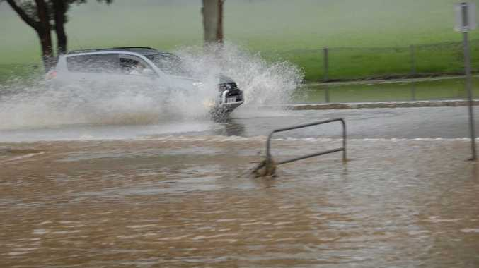 Early morning storms cause flash flooding in Toowoomba, water over road corner of Mackenzie and Long Streets.