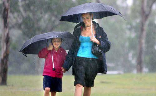 Lisa Poole takes daughter Chloe Sheridan to school in the rain.