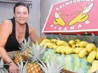Growers Own Mackay branch operations manager Judi Connor displays locally-grown Balnagowan bananas. Mackay bananas are providing an alternative after Cyclone Yasi destroyed crops in Far North Queensland.