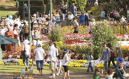 Tourism bosses are urging residents to explore their own backyard, like Queens Park, to boost the region's economy.