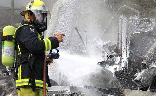 Firefighters donned self-contained breathing apparatus to fight the blaze.