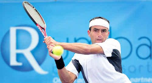 Aussie Marinko Matosevic in action against Brydan Klein at the Caloundra International Tennis tournament yesterday.