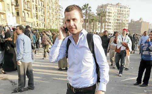 Former Toowoomba journalist Dan Nolan filing a report from Cairo's Tahrir Square just before violence erupted between pro-government forces and protesters.
