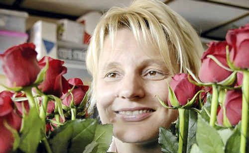 Swish Flowers owner Marie Streidl hopes local love birds will support the flood-affected cut flower industry this Valentine's Day.