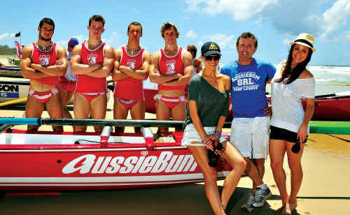 aussieBum principal Sean Ashby at Peregian Beach with Carlee Opitz (left) and Angela Shallis and the Currumbin Under 19 boat crew.