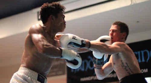 Philippine fighter Jack Asis (left) ended Sunshine Coast lightweight Brett Smith's unbeaten run at Maroochydore.