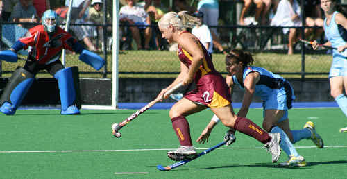 Queensland Scorchers striker Amy Korner (number 12) is looking to this year's national league to rebuild her international hopes.