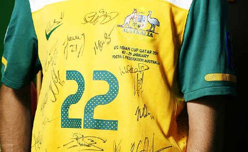 The signed Australian Socceroos shirt being auctioned to raise money to help Ipswich flood victims.