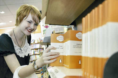 Casey Delahunty searching through the classics section for her favourite book Pride and Prejudice in Angus and Robertson.