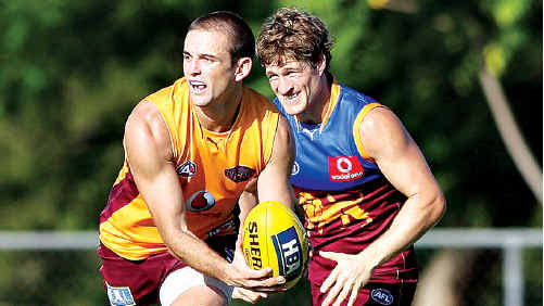 The Brisbane Lions' Josh Drummond, left, has been restricted to limited training after injuring a hip during the pre-season.