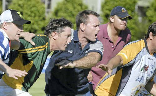 Former Wallaby Pat Howard (centre) leads Darling Downs in a pre-season training run at Gold Park last Saturday.