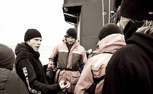 Steve Irwin sailing master Mal Holland, from Yaroomba, explains the new action plan to the crew at Antarctica.