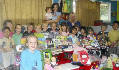 SHARING IS CARING: Staff and students at Gardiner Avenue Children's Centre.