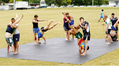 Ipswich Jets players and coaching staff go through a pre-season training session.