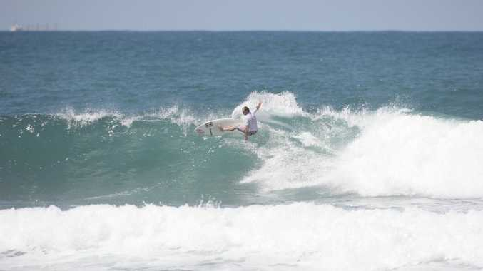 Trevor Tripcony catches a wave at the Ma and Pa Bendall Memorial surf competition at Moffat Beach.
