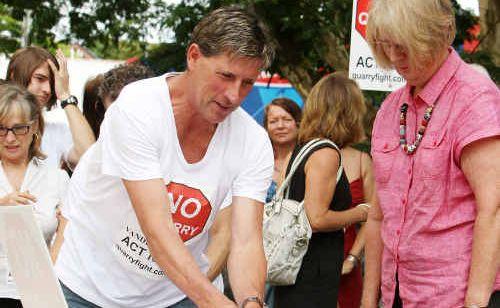 Alex Watson hands over protest letters to Cr Vivien Griffin.