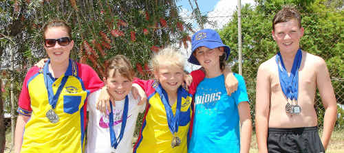 Warwick Swimming Club members (from left) Caitlyn Spies, Abby Grayson, Caitlin Skaines, Samantha McMahon and Jonathon Skaines after strong performances at the Texas carnival.
