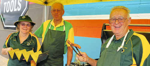 Moore Park Lions Jan Walker, Ian Horneman and Bill Ware cook up a great feed of snags.