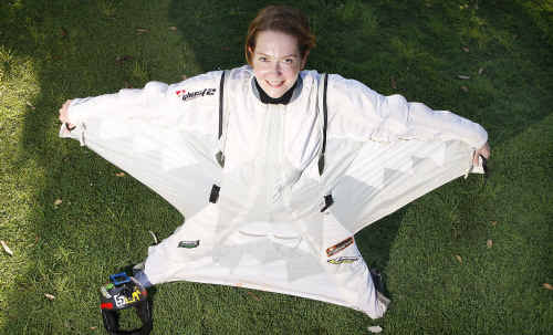 Kirsten Moriarty tries on a wing-diving suit in readiness for when she can return to her loved sport of sky diving. She has spent seven months recovering from a near-death parachuting accident.