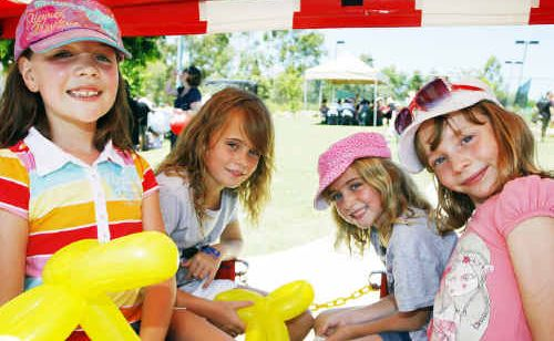 ENJOYING the Brookwater Summer Family Fun Day were (from left) Hannah Couch, eight, Charlie Browne, nine, Hayley Browne, seven, and Lauren Couch, six, all of Augustine Heights.