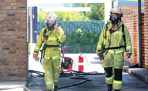 Firefighters investigate a fire at Red Rooster Kawana that forced staff to evacuate the building.