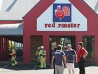 Fire crews extinguish a fryer fire at Buddina Red Rooster this morning.